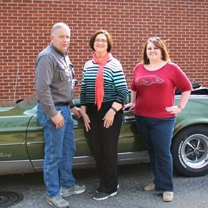 Together, Courtney Allen (far right) and her parents lost more than 250 pounds.