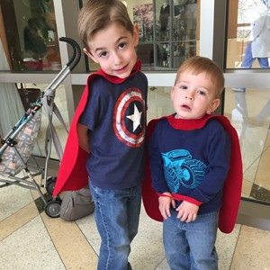 Cole and Cooper Leslie don their new capes.