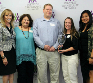 Jan Finn, COO, Midwest Transplant Network (far left), presents the award to (from left) Kathy Drenick, RN; Kevin Kepley, manager, RN; Alicia Marshall, RN; and 	N.J. Smith, RN; of the intensive care unit and cardiovascular intenstive care unit.
