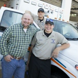 Mercy paramedics Kenny Dalton and Casey Fowler pose with Josh Britt