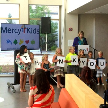 Jean Gruetzemacher, vice president of Mercy Health Foundation Springfield, joins Mercy Kids to announce donation halfway mark.