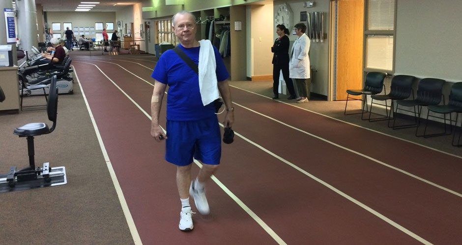 Now equipped with an LVAD, Bill Besore works out several times each week at Mercy Cardiopulmonary Rehabilitation, walking and lifting weights.