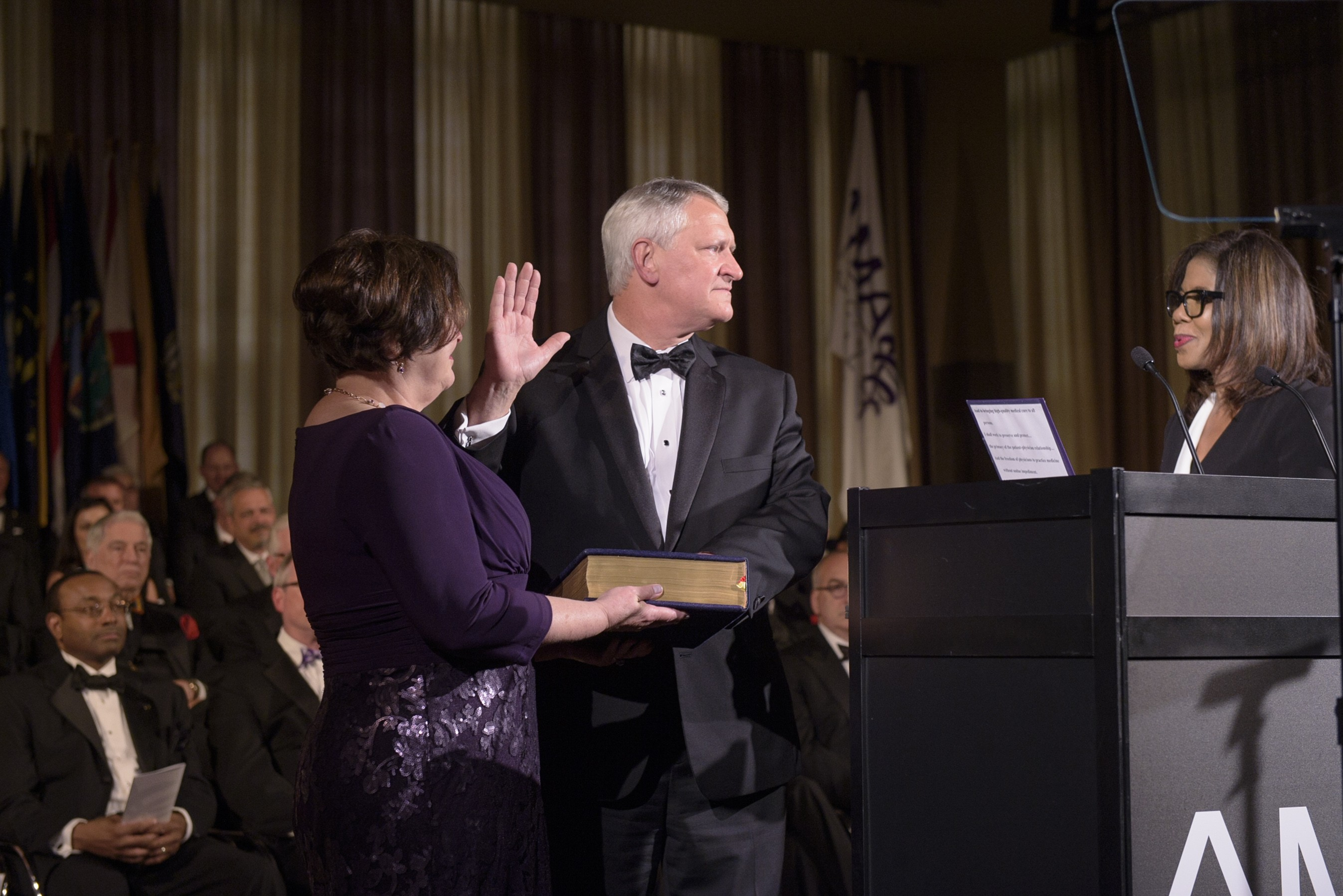 Dr. David Barbe, a Mercy physician from Mountain Grove, Missouri, takes the oath of office as the new president of the American Medical Association. His wife, Debbie, holds the Bible.