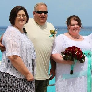 Allen (far right) with her parents on her wedding day.