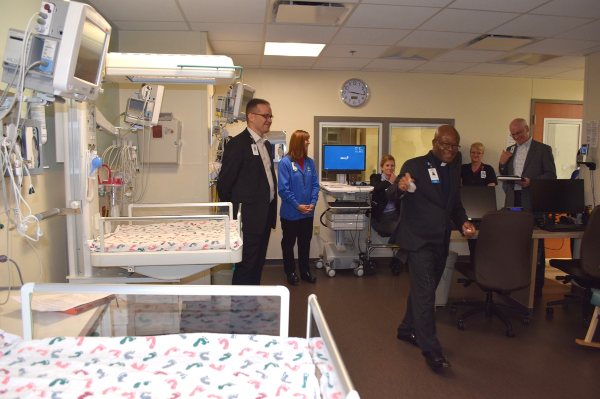 Father Jerome Amaechi blesses Mercy Hospital Springfield's newly relocated Special Care Nursery.