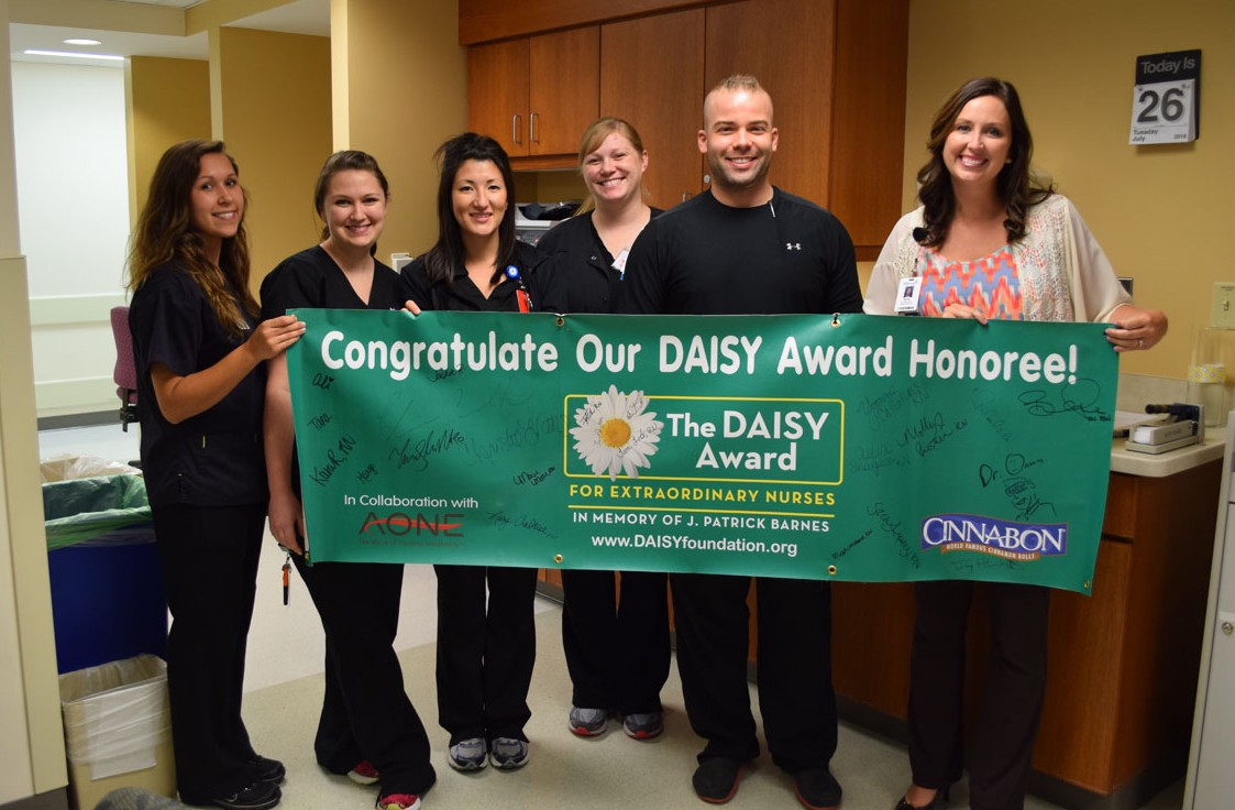 Trauma ICU co-workers with nurse Brandon Ruble, one of Mercy Hospital Springfield's recent DAISY award recipients.