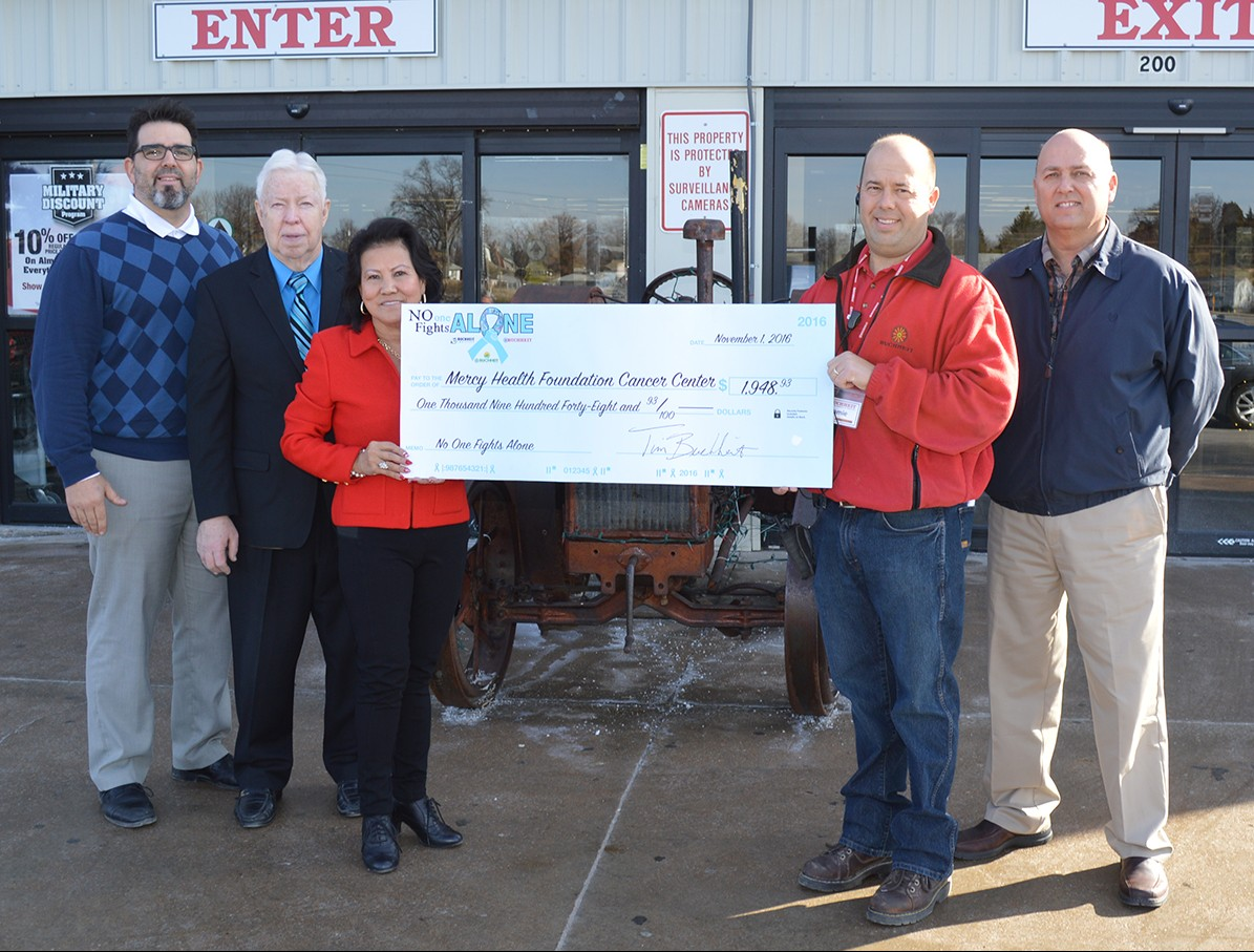 Buchheit in Herculaneum store manager Jamie Schilling presented a check to Mercy Health Foundation development director Andy Held, and board members Dan Glore, Tammy Fadler and Bruce King.