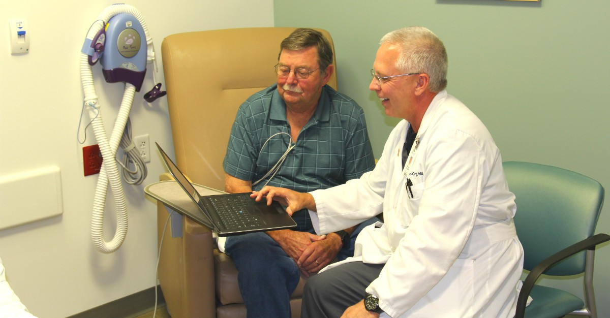 Dr. William Craig reviews the device's readings with patient Lewis Brooks.