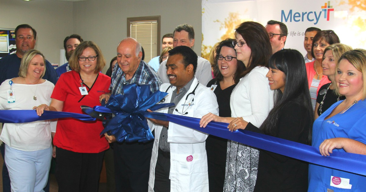 Dr. Joseph Mayo cuts the ribbon while Dr. Krishna Kosuru holds the bow Tuesday during a ribbon cutting at Mercy Clinic Pediatrics – Carthage. The clinic moved in early July to a new, more convenient location at 2425 Fairlawn Ave.