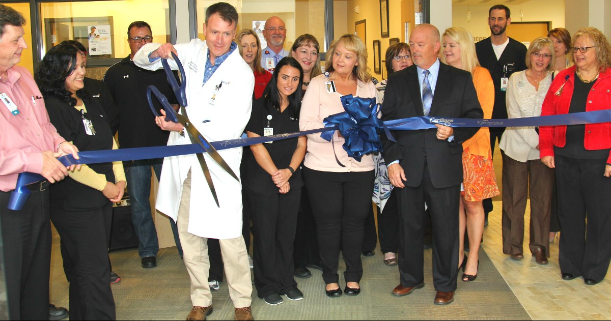 Dr. William Park Triplett cuts the ribbon to formally open Mercy Clinic Family Medicine and After Hours Care at Mercy Hospital Joplin.