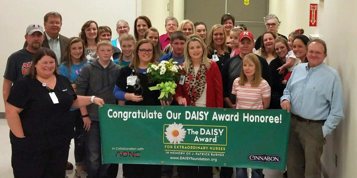 Danielle Schutte and her co-workers celebrate at Mercy Hospital Aurora.