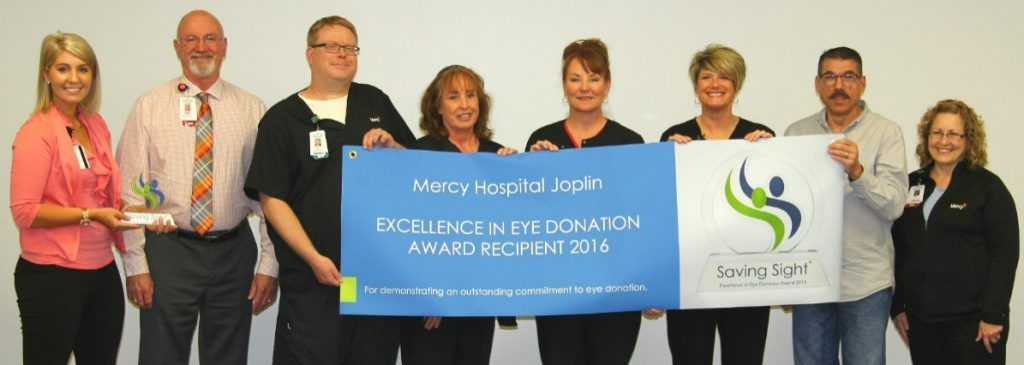 Haley Lyne (far left) of Saving Sight presents the Excellence in Eye Donation Award to Dennis Manley (second from left), chief nursing officer of Mercy Hospital Joplin.