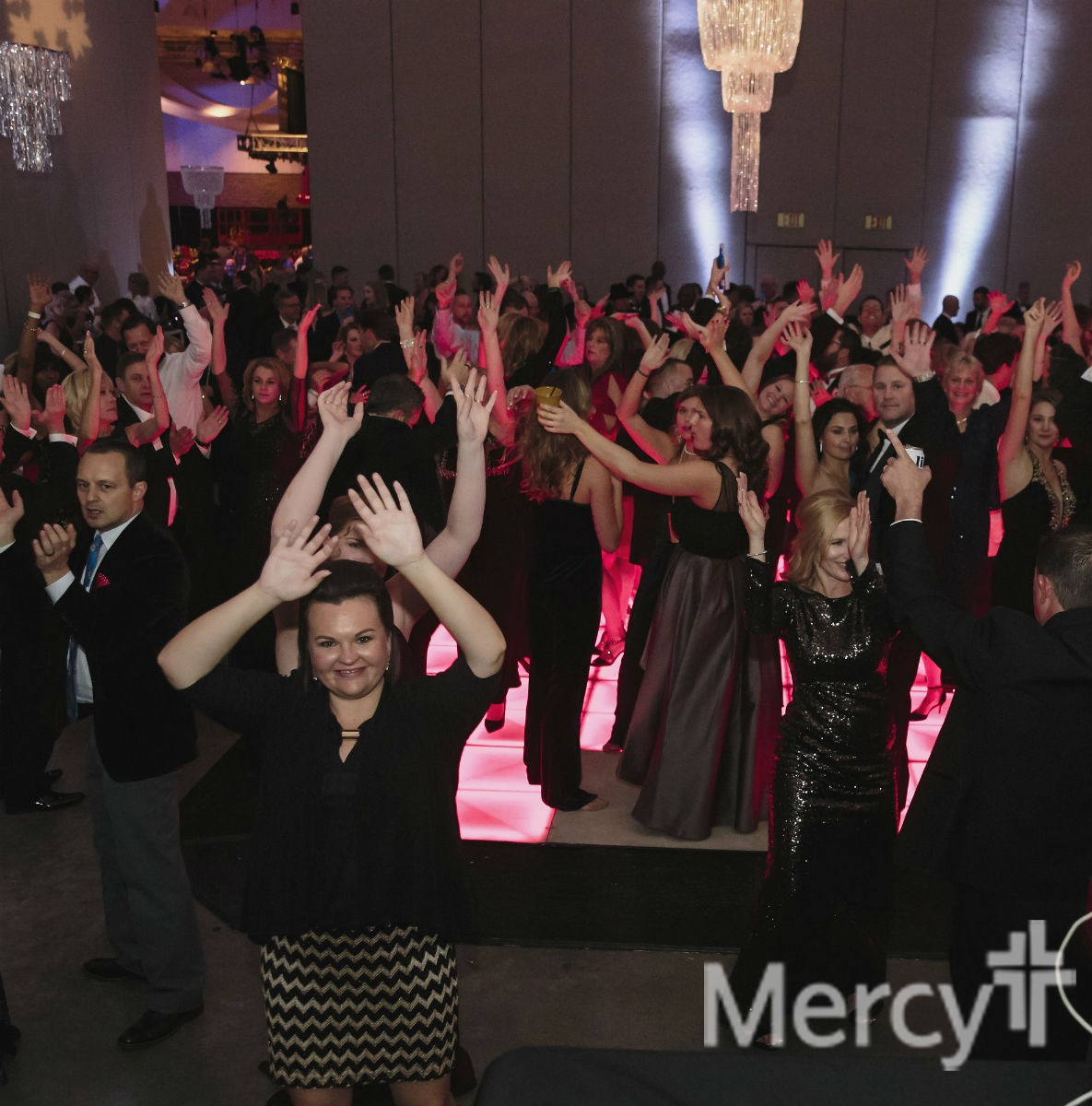 Mercy White Christmas Charity Ball revelers celebrate during the Defrost After Party.