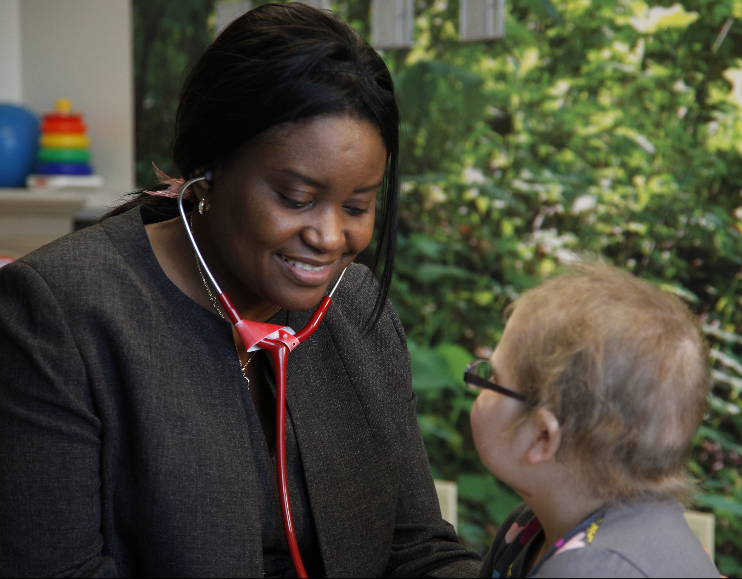 Dr. Francisca Fasipe, Mercy pediatric oncologist/hematologist, examines a patient. Mercy Springfield has a variety of local specialists, including dozens of pediatric subspecialists, who will be in-network for some Anthem Blue Cross and Blue Shield plans starting Jan. 1, 2018.