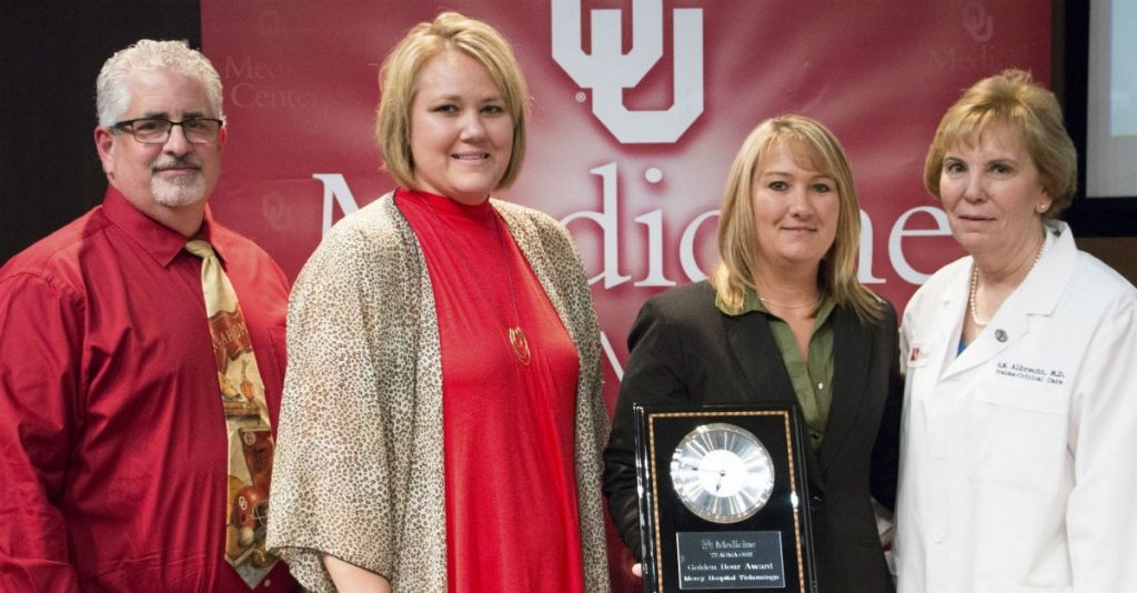 "Mercy Hospital Tishomingo co-workers Steve Saltiel, Jennifer Imotichey and Ashley Smalling (pictured left to right with OU Medical Center's Dr. R.M. Albrecht) accepting the ""Golden Hour"" Award."