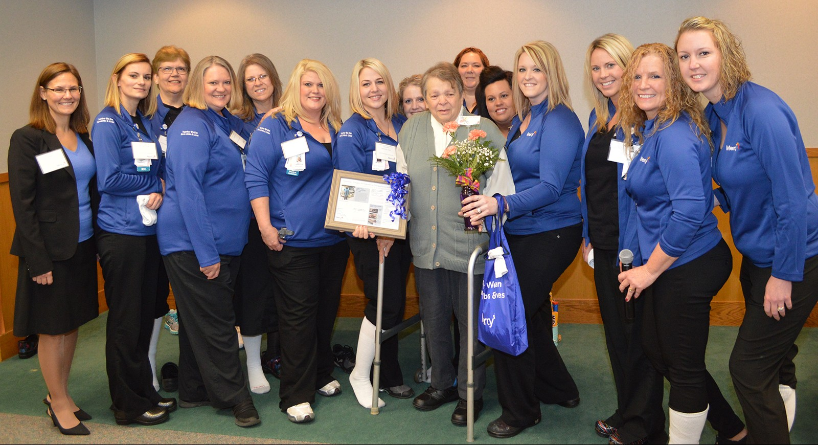 Members of the Wound Care team surround Patricia Jones after her presentation during the Limb Preservation Symposium.