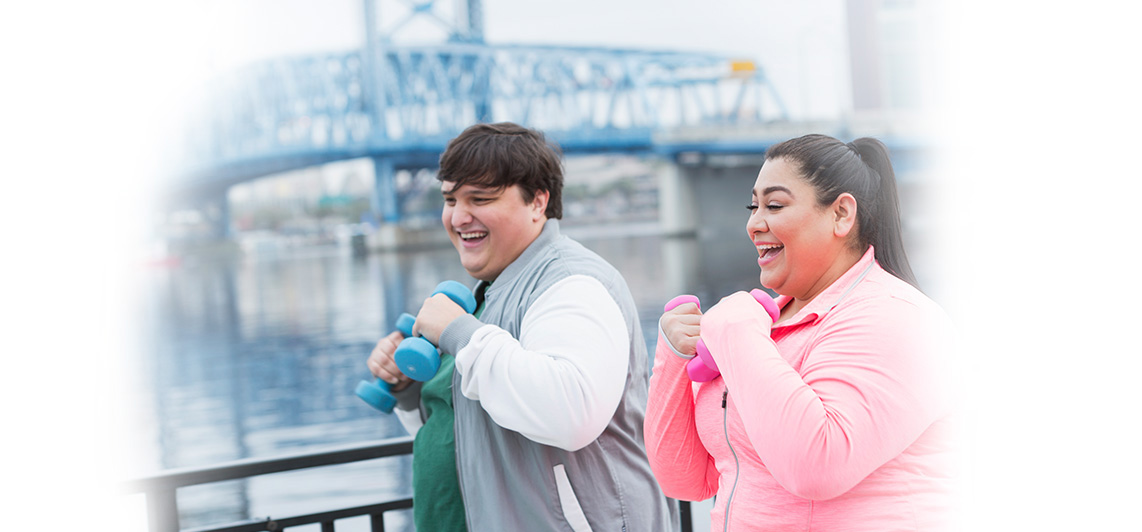 Couple exercising for improved health