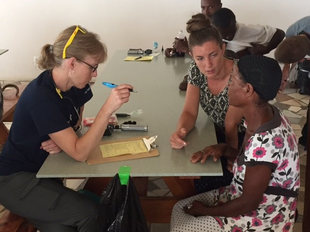 Mercy co-workers from St. Robert, Missouri, meet with patients in Haiti.