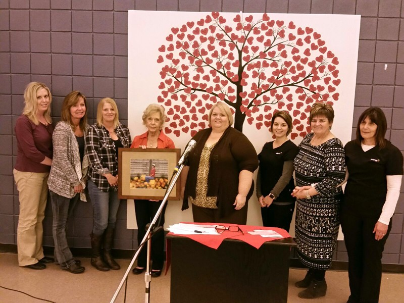 From left to right: Katie Stuart, social worker; Connie Becker, RN; Joy Rivera, RN; JoAnn Rosipal, Janet Archibald's mother; Samantha Day, director of clinical operations; Allison Tidwell, nursing supervisor; Judy O'Connor-Snyder, executive director of operations; and Sharon O'Quinn, RN; holding a photo of Janet Archibald, which will be hung in family gathering space just outside Mercy Hospital Lebanon's palliative care room.