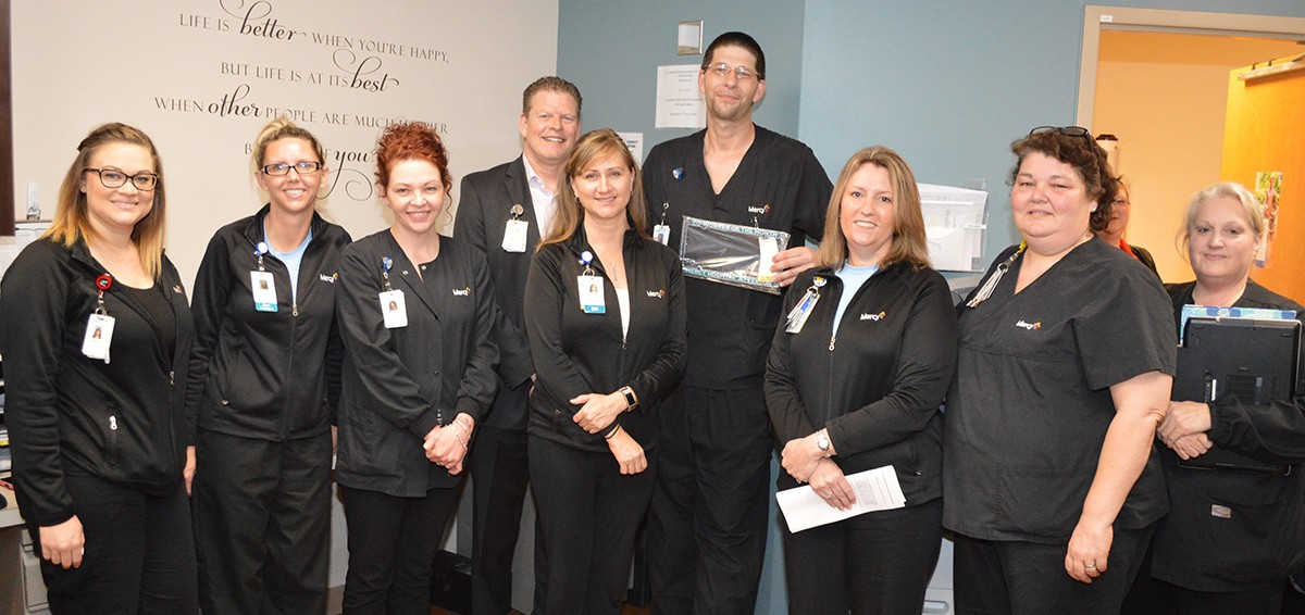 Behavioral Health Tech Jason Stacy calmed and cared for a patient in a medical floor room.