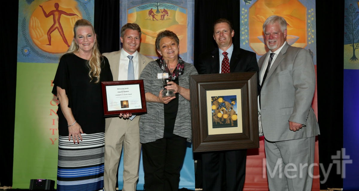 Pictured are: Juli Stec, chief operating officer of Mercy Hospital Fort Smith; Martin Schreiber, vice president of mission for Mercy Fort Smith; Jaquetta Newton, Co-Worker Lamplighter Award recipient; Ryan Gehrig, president of Mercy Hospital Fort Smith; and Dr. Cole Goodman, president of Mercy Clinic Fort Smith.