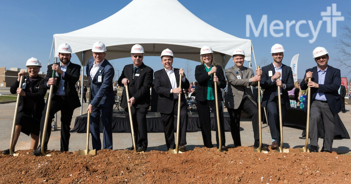 Sister Anita DeSalvo, Chad Raith, Dr. Steve Goss, Mayor Jackie Crabtree, Andy Thompson, Cindy Bosley, Kerry Harper, Bill Hewlett and Eric Pianalto get ready for a symbolic groundbreaking for a new primary care clinic in Pea Ridge.