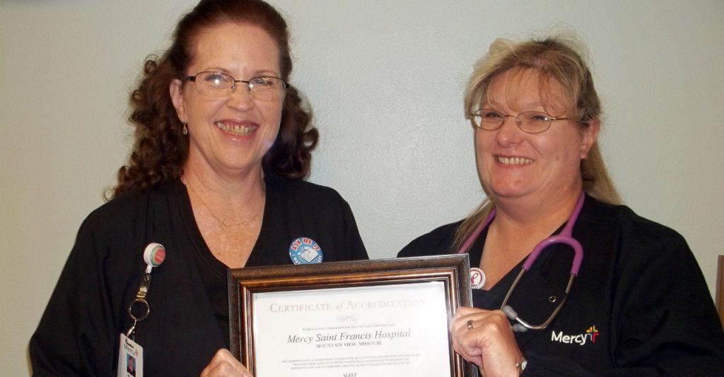 Sleep center manager Mirian Johnson (left) and sleep technician Annette Johnson display their sleep center accreditation certificate.