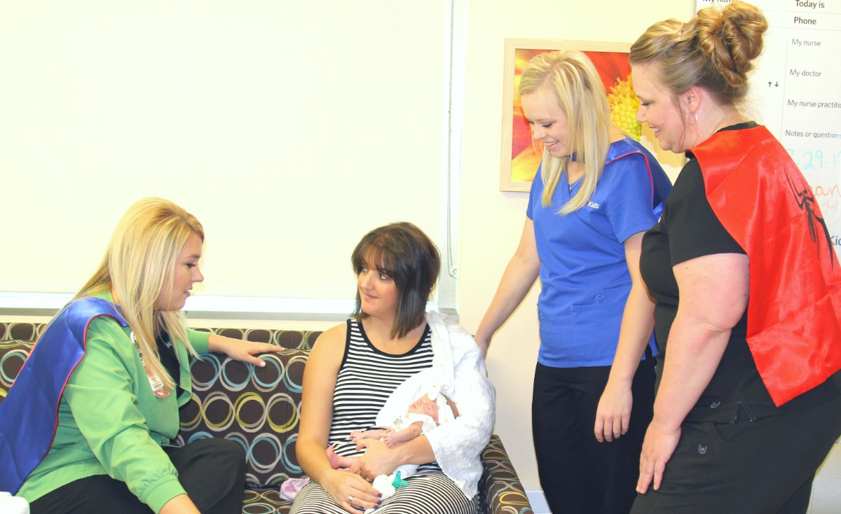 The Mercy Hospital Joplin superhero neonatal nurses visit with mom Melinda Feather and Emery, who was born at 2 1/2 pounds, stayed in the neonatal intensive care unit (NICU) for 48 days and was more than 4 pounds when she and mom visited the NICU.