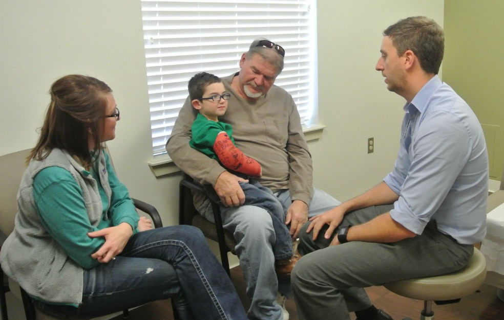 "When Katy and Michael Perez's 3-year-old son, Ridge, broke his arm in November, they went to Dr. Cody Curry, an orthopedic surgeon in Ada. Pictured L to R: Katy Jo Perez, Ridge Perez, Chuck Lancaster (""Pawpaw"") and Dr. Cody Curry."