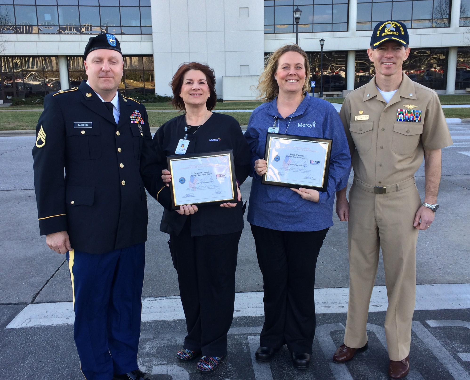 Staff Sgt. David Mardis, a Mercy medical assistant, nominated his supervisors, Donni Franiak and Sarah Thomas, for the Patriot Award. Cmdr. James Griffin, of Springfield's Navy Operational Support Center, made the official presentation.