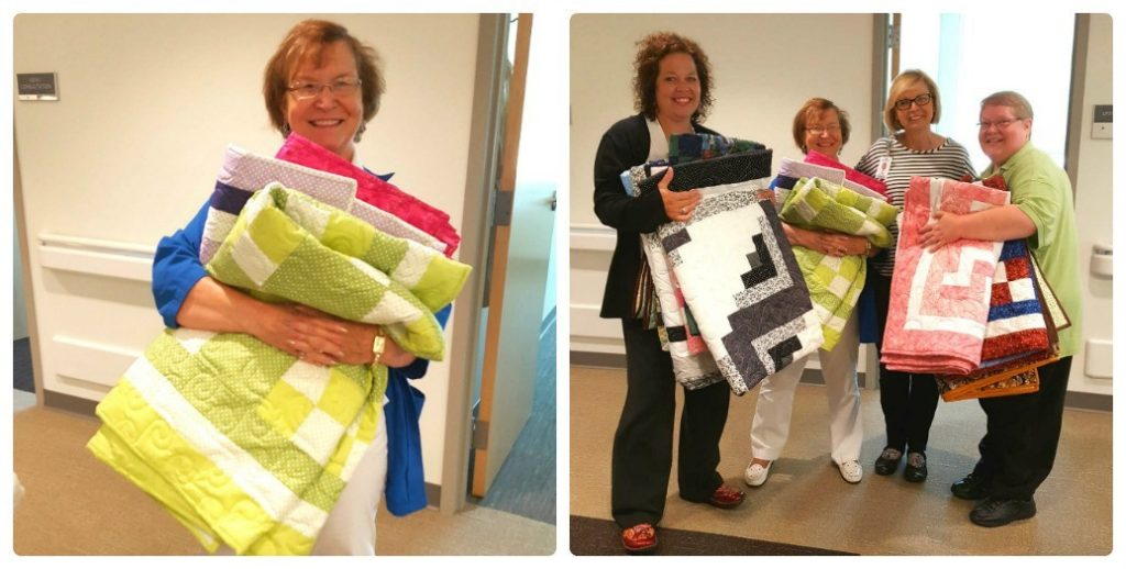 Volunteer Marie Judd (left) of the Mercy Cancer Center holds up sevearal of the quilts she made and donated. Helping Marie show off all of the quilts (from left) are Allison Odell, social worker; Rita Glaze, nurse navigator; and Jan Brown, patient access representative.