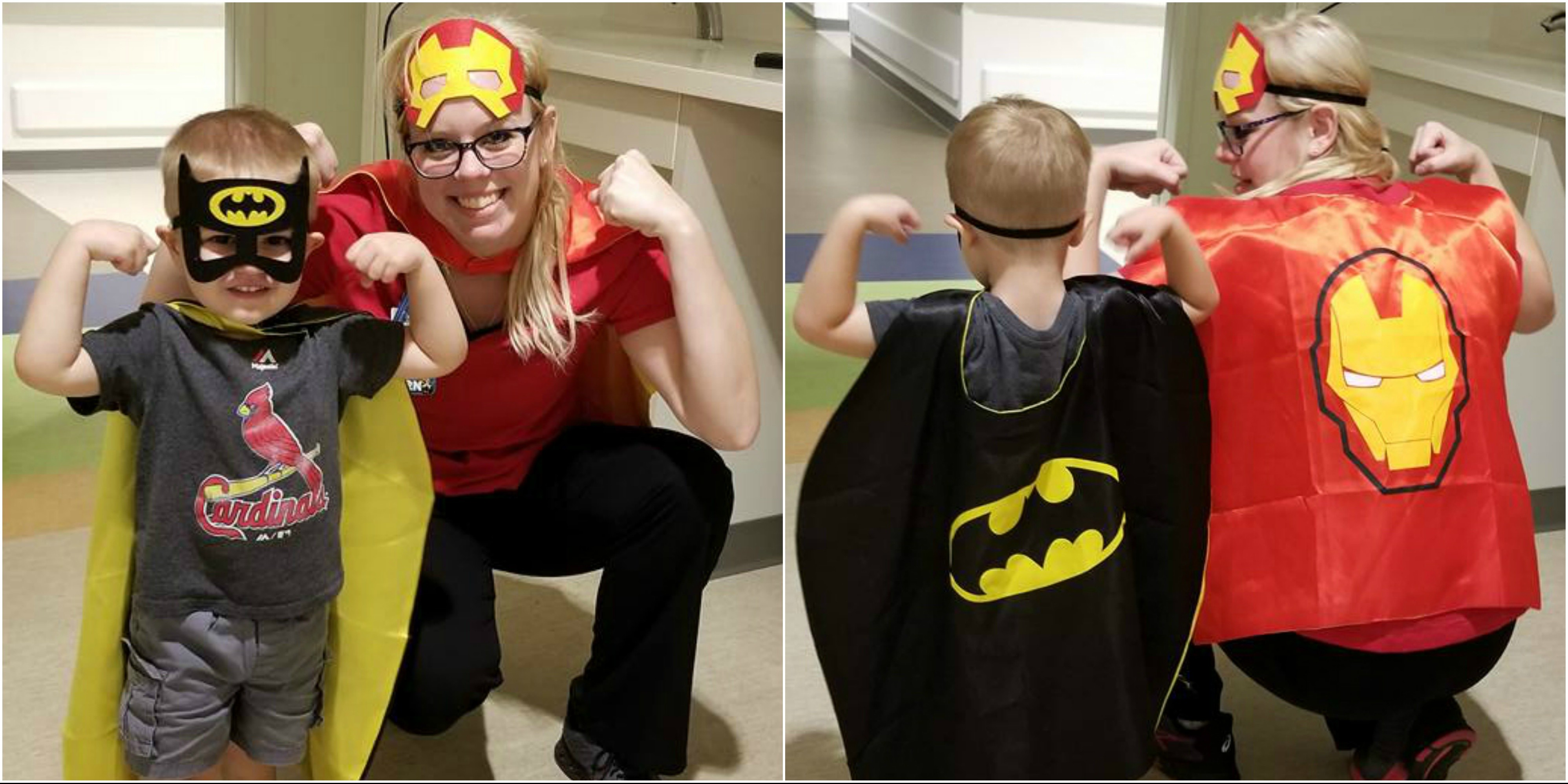 Caden Feather, 3, and neonatal nurse Megan Burrows display their super powers.