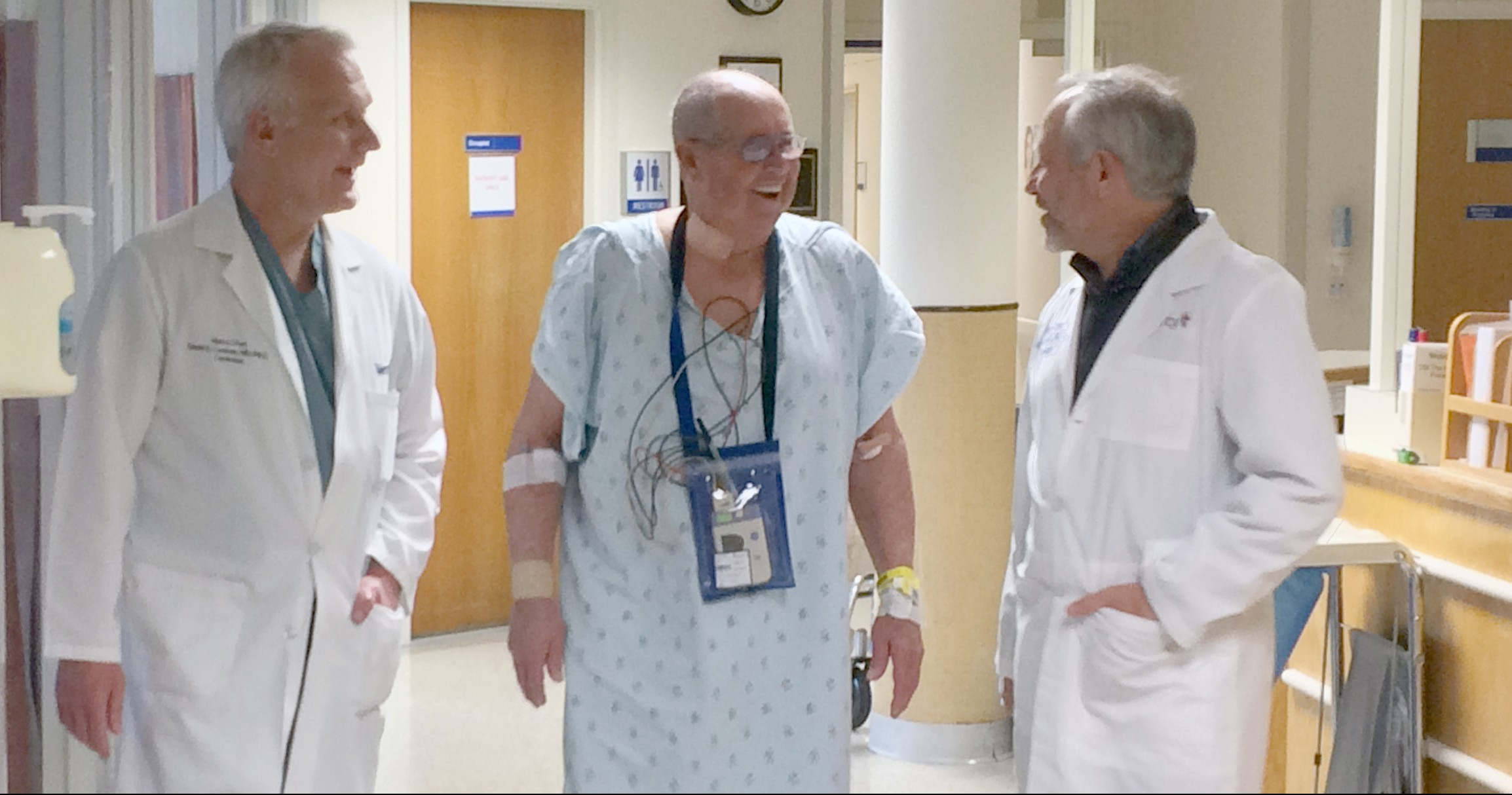 Alvin Hawkins walks the halls of Mercy Hospital Springfield with Dr. David Cochran (l) and Dr. Robert Merritt (r) the day after his TAVR procedure.