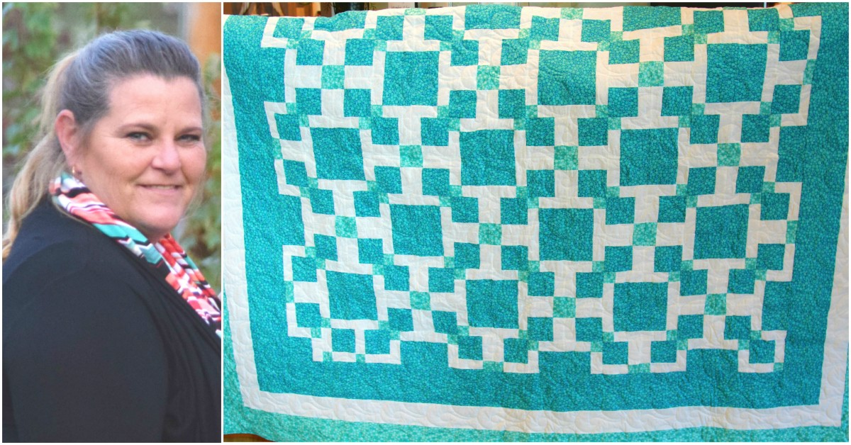 The teal and white quilt has been donated to honor cervical cancer survivor Jackie Judd.