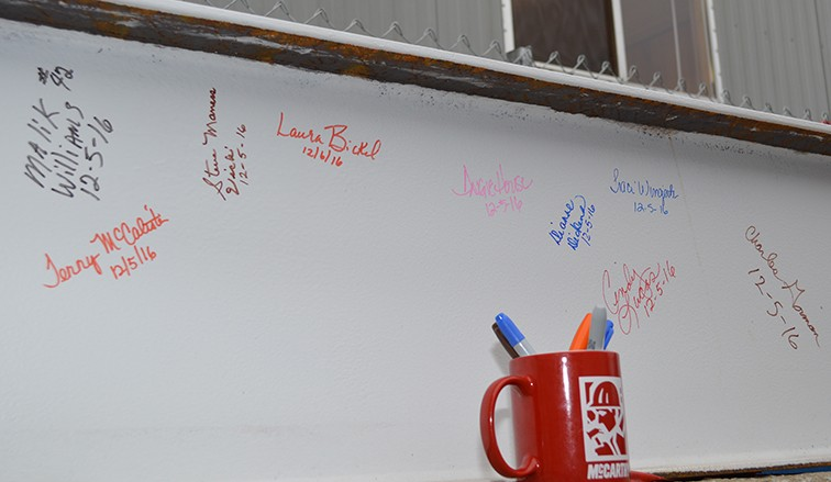 Hundreds of co-worker signatures will cover the final beam being placed on the new patient tower.
