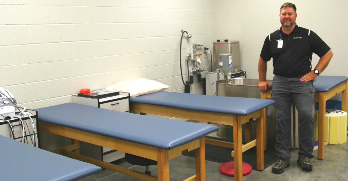 Ryan Palmer, a certified athletic trainer for Mercy Sports Medicine and head trainer for Carthage School District, shows off the Mercy training room inside the newly built field house at the high school complex. McCune-Brooks Healthcare Foundation donated $50,000 for the training room, which includes almost $9,000 worth of equipment and supplies donated by Mercy.