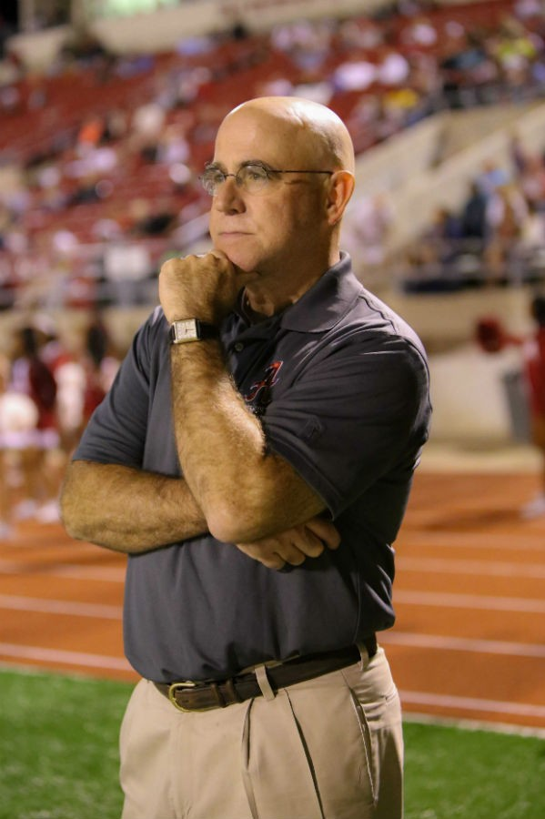 "Working on the sidelines of high school football games is something Dr. Joel Troop calls a ""labor of love."""