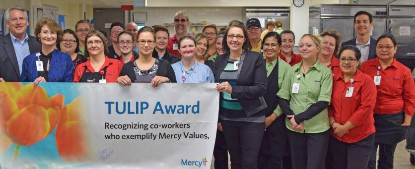Erin Milner, standing third from left, front row, is joined by members of Mercy Hospital Springfield's Food Services.
