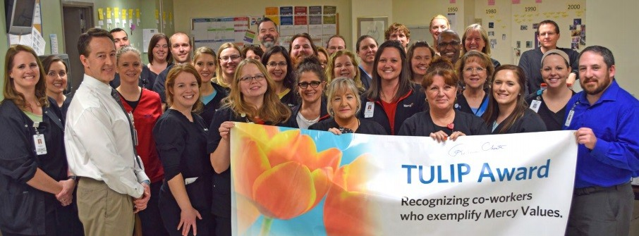 Mercy Hospital Springfield's Acute Therapy Services group celebrates with Rebecca Choate. Rebecca is standing third from right, front row.