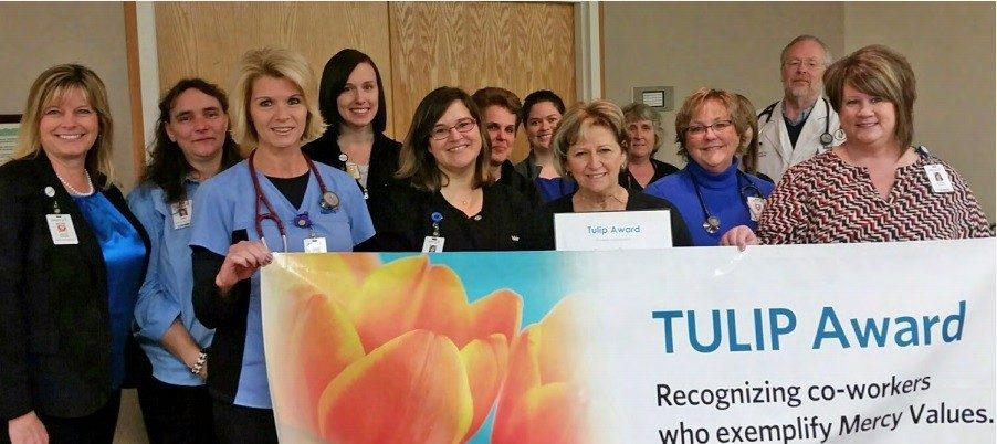 Mercy Clinic Family Medicine-Branson West celebrate with Tulip recipient, Rhonda Tyree, standing fourth from left, front row.