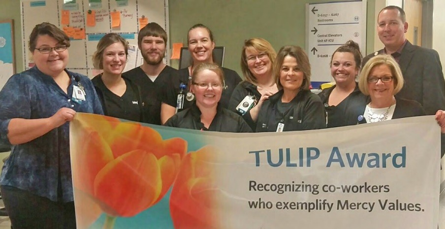 Sammi Downing, standing second from left, front row, is joined by members of Mercy Hospital Springfield's Neuro Trauma Intermediate PCU.