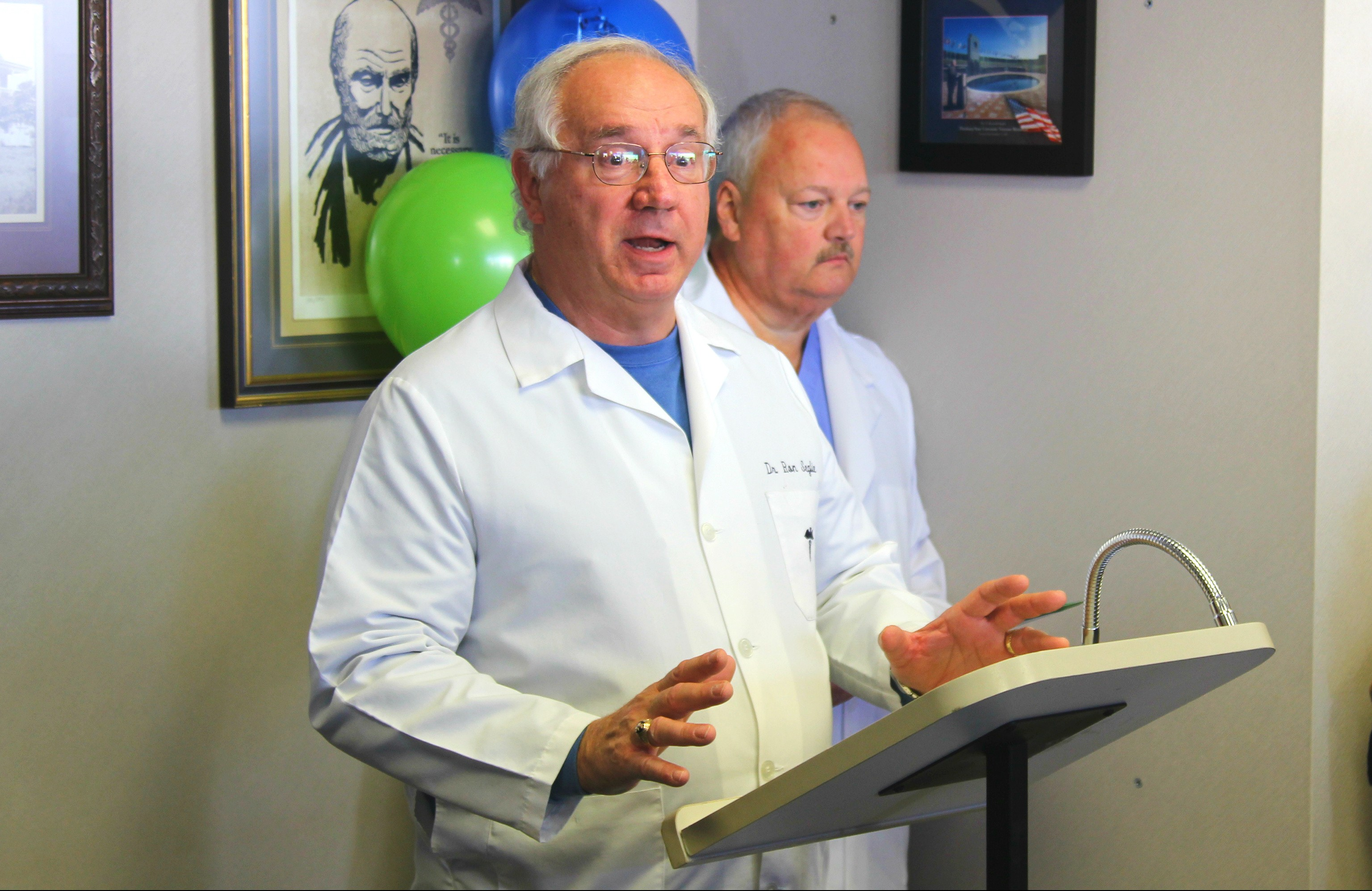 Dr. F. Ron Seglie welcomes dignitaries for the ribbon cutting of the Via Christi Mercy Clinic temporary location in Pittsburg. Behind Dr. Seglie is Dr. Kent Coltharp, a second doctor at the clinic.