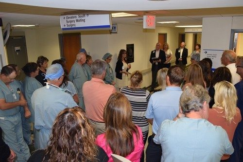 During the dedication ceremony, co-workers gathered in the Third Floor OR hallway at Mercy Hospital Springfield, where one of the four Shipman legacy stones is mounted on the wall.