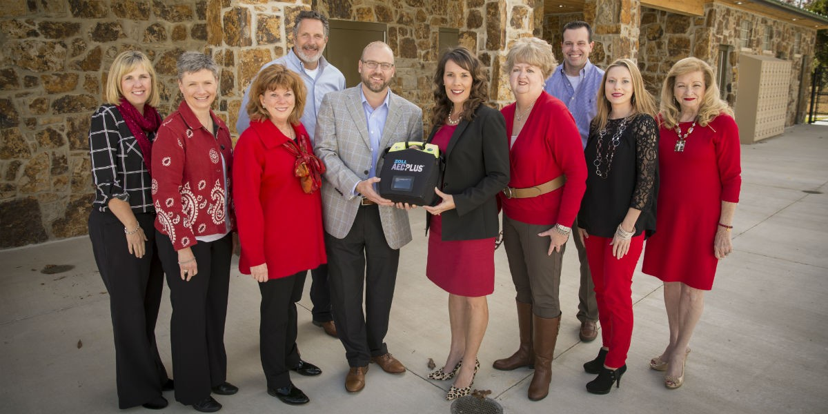 Members of the Wear Red for Women committee recently donated an AED funded by the 2016 Wear Red for Women luncheon to the new Wintersmith Aquatics Center.